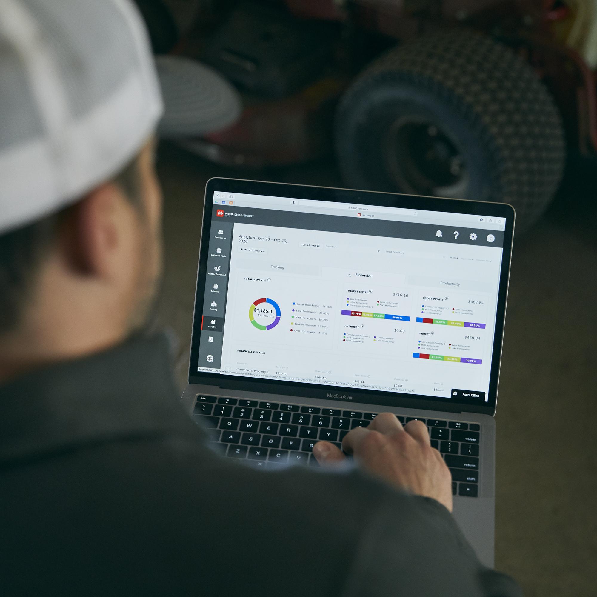 man using toro horizon360 software on laptop