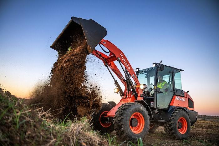 A Kubota R640 wheel loader dumping a bucket of dirt onto a pile