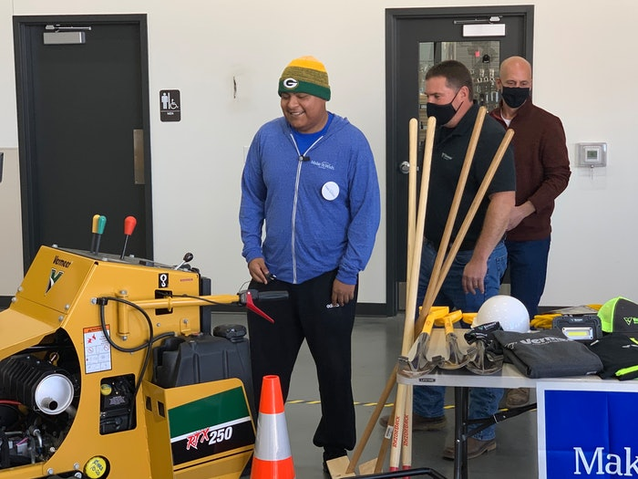 Edgar Contreras being presented with landscaping tools as part of Make-A-Wish Day at Vermeer Wisconsin