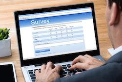 man taking an online survey on a laptop computer