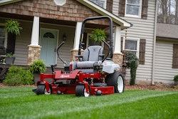 Exmark radius zero turn mower on front lawn of house