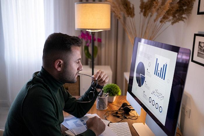 Man at desk looking at computer screen