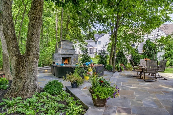 outdoor patio with firepit and seating area