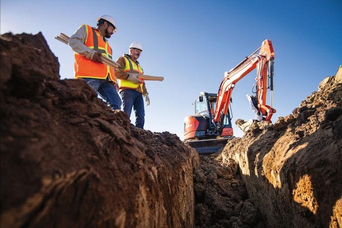 Kubota U48-5 excavator digging on jobsite