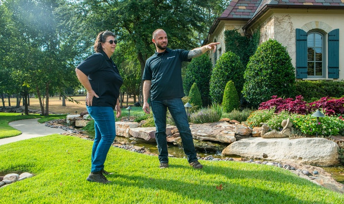 Landscaping professional speaking with client