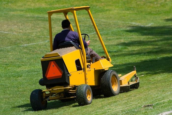man operating landscaping equipment