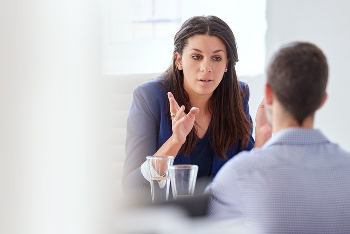 woman talking to man in workplace