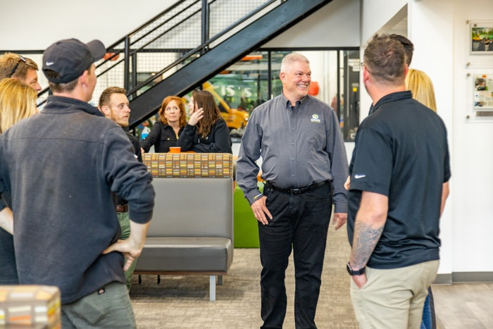 Oasis Turf & Tree owner Rob Reindl with employees