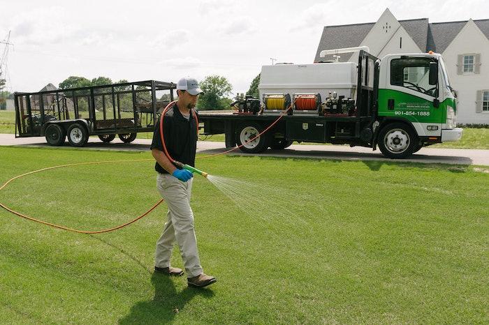 technician spraying lawn