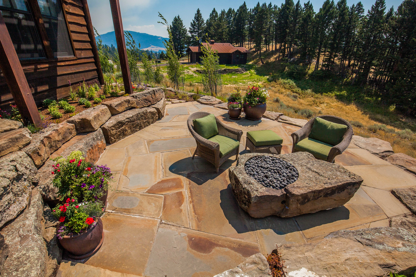 outdoor seating area on rock patio