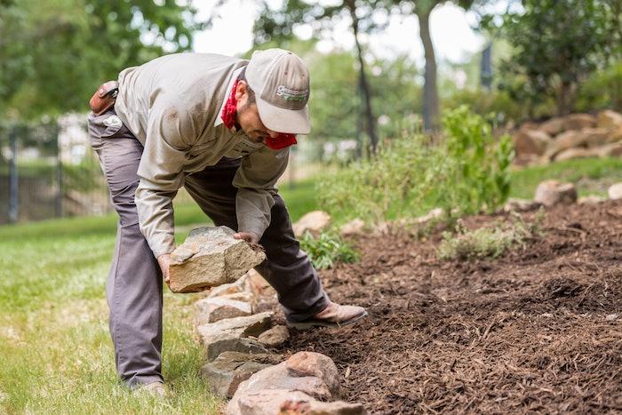 landscaper creating a rock edge