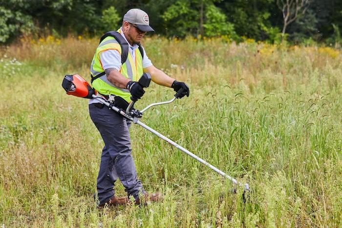 man operating brushcutter